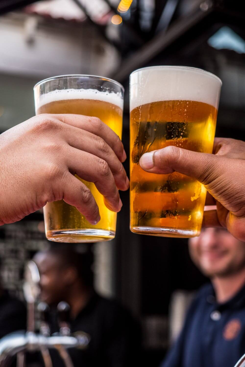 https://www.pexels.com/photo/two-persons-holding-drinking-glasses-filled-with-beer-1089930/